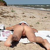 Stripped beach likes nude.