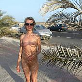 Naked portraits on beach.
